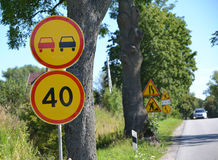Road signs Overtaking is forbidden, Restriction of the maximum speed of 40 km against the road Stock Photo