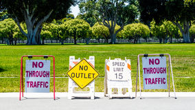 4 road signs in a park Royalty Free Stock Photography