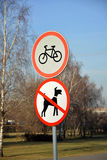 Road signs. In park: No cycling and No dogs allowed Royalty Free Stock Images