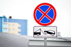 Road signs Parking prohibited and Evacuation of vehicles. In the urban background stock image