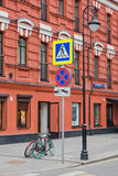 Road signs and pedestrian crossings in the city. Road signs and pedestrian crossings in city center Stock Photo