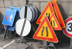 Road signs piled in a warehouse of the company of asphalting Stock Photos