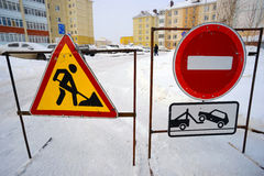 Road signs prohibiting passage when clearing snow in  yards. Road signs prohibiting passage when clearing snow in the yards Stock Images