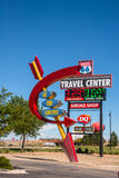 Road Signs Rest Stop Route 66. ROUTE 66, NEW MEXICO - SEPT 6, 2014: Americana retro and modern neon travel signs juxtaposed at rest stop along old Route 66, the Royalty Free Stock Images