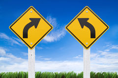 Road signs,  right or left curve on sky background. (Clipping Pa Royalty Free Stock Photography
