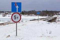 Road signs in road bridge across the river Vaga near the village Klopovskaya Stock Images
