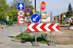 Road signs at the road construction Stock Photos