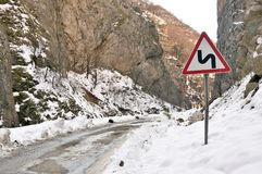 Road signs. The roads in the snow-capped mountains. Stock Images