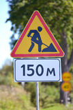 Road signs Roadwork, Distance of 150 m against greens Royalty Free Stock Image