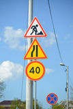 Road signs Roadwork, Narrowing of the road at the left, Restriction of the maximum speed of 40 km, The stop is forbidden.  Stock Image
