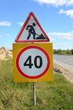 """Road signs  """"Roadwork"""" and """"Restriction of maximum speed of 40 km"""" Royalty Free Stock Image"""