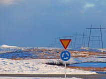 Road signs: roundabout and yield Stock Images