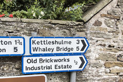 Road Signs in the small village of Pott Shrigley, Cheshire, England. Stock Images