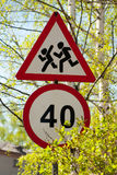 Road signs speed limit and danger kids Stock Photos