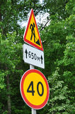 Road signs speed limit and repair the road Royalty Free Stock Photos
