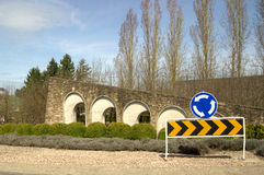 Road signs in stone wall Stock Photos