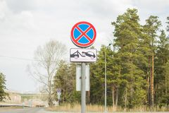 Road signs. Stop is prohibited. The tow truck works royalty free stock photos