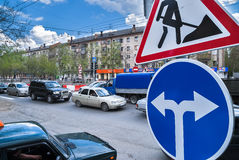 Road signs in street under reconstruction Stock Image