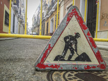 Road signs in a street under reconstruction symbol in old town Stock Images