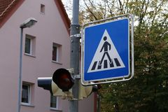 Road signs on the streets. Road Sign Pedestrian Crossing. Road signs on the streets. Road Sign Pedestrian Crossing royalty free stock photography