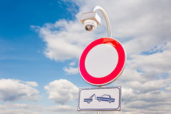 Road signs and surveillance camera. Stock Images