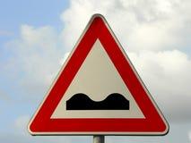 Uneven road ahead. Danger road sign Stock Photo