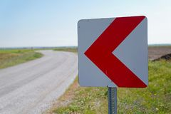 Road signs warning drivers about ahead dangerous curve royalty free stock photography