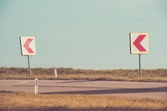 Turn left sign on a country road. Road signs warning drivers about ahead dangerous curve stock photos