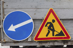 Road signs warning about the repair of the road Stock Images