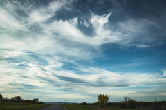 Road Sky and Clouds. Vehicle point-of-view, sunny day with wonderful sky Royalty Free Stock Image