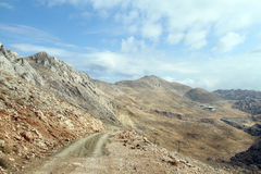 Road from Nemrud Dagi, Turkey. Road on the slope of mount near Nemrud Dagi in Turkey Royalty Free Stock Images