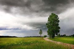 Road. Small lane in rural area with stormy skies stock photography