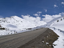 Road in the Snow. Road leading to a beautiful snowy landscape Stock Images