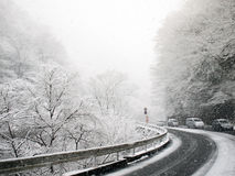 Road in snow. Road and traffic in heavy snow Stock Photos