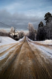 A road with snow. In winter stock photo