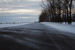 Road in a snow blizzard in the day Stock Photography