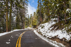 Road with snow and blue sky Royalty Free Stock Photography