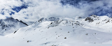 Road in the snow capped mountains Stock Images