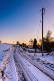 Road through snow covered farm fields in eastern York County, Pe Stock Photos