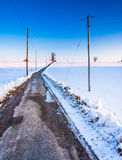 Road through snow covered farm fields in eastern York County, Pe Royalty Free Stock Photography
