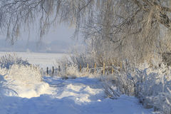 Road through snow drifts. Winter, frost, snow drifts, beautiful winter landscape Stock Photo