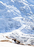 Road on snow mountain hills in Winter Stock Photos