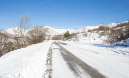 Road in the snow mountains Royalty Free Stock Image