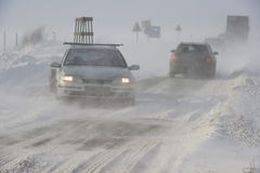 Road in snow storm. Snowstorm, poor visibility, slick roads and lots of traffic Royalty Free Stock Photos