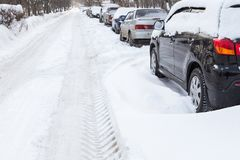 Road in the snow with cars on the roadside Royalty Free Stock Photo