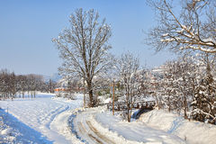 Road on snowy field. Piedmont, Italy. Royalty Free Stock Photos