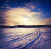 Road through snowy field Royalty Free Stock Images