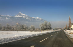 Road in snowy landscape Royalty Free Stock Images