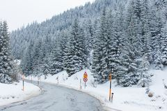 Road through snowy mountains Stock Photos