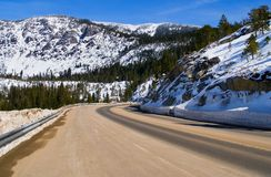 Road through snowy mountains.  Royalty Free Stock Photography
